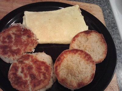 folded ham n cheese omlette potatoe patties n toasted english muffin