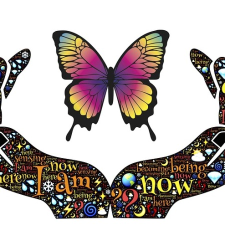 drawing of hands releasing a butterfly. Words written inside hands; I am now, here, ?, becoming