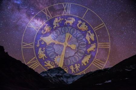 the zodiac wheel of symbols setting among mountains, like the sun would do