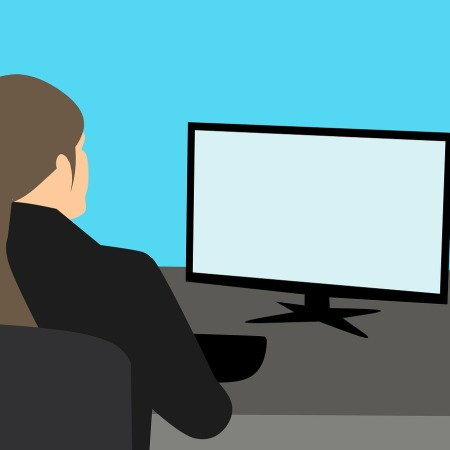 Simple 'cartoon' image of the back of a lady's head, sits in a chair, with monitor on table in front of her and keyboard at hand.